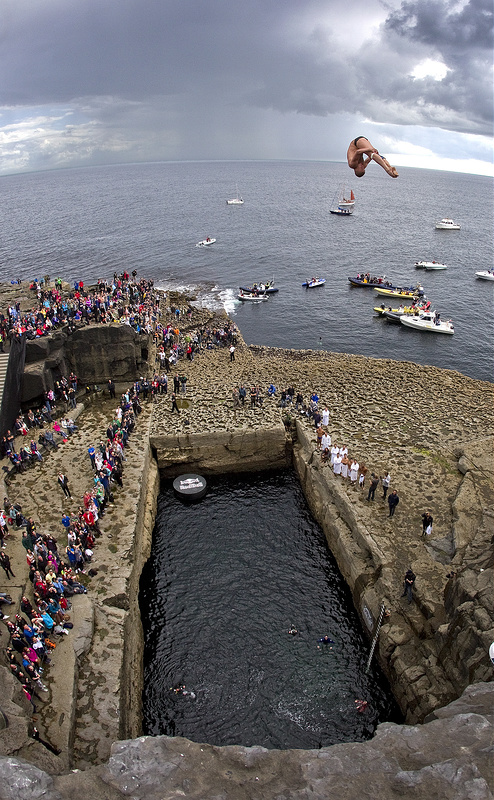 "Artem Silchenko of Russia dives from the 28 metre platform during the fourth stop of the Red Bull Cliff Diving World Series, Inis Mor, Aran Islands, Ireland on August 4th 2012. // Romina Amato/Red Bull Content Pool // P-20120804-00063 // Usage for editorial use only // Please go to <a href=""<a href="